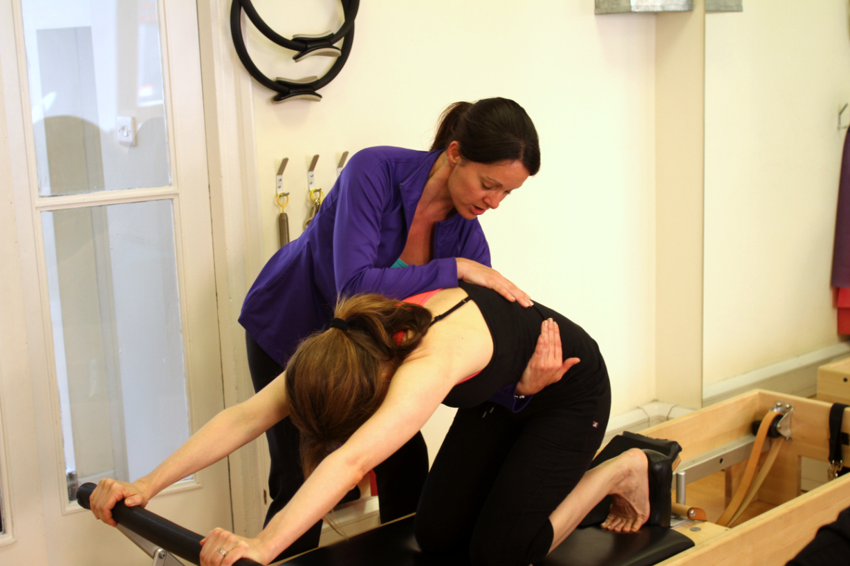 slide%205%20the%20pilates%20place%20crouch%20end%20Larrisa%20teaching%20kneestretch